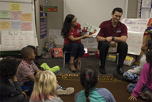 Reading to students in Classroom